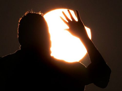 first-partial-solar-eclipse-2011-viewers-hand_30849_600x450.jpg